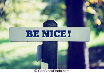 Be nice signpost in beautiful woodland with a vintage...