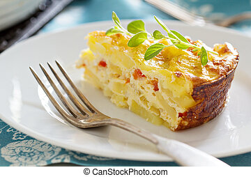 Potato and pepper breakfast gratin with parmesan
