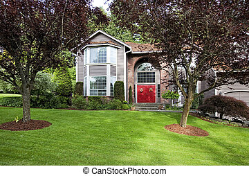 Luxury house exterior - Large siding house with high brick...