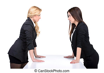Competition - Women confrontation Two angry women looking at...