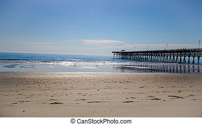 Myrtle Beach Pier - Wooden pier juts into the blue waters of...