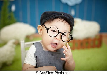Cute baby wearing reading glasses