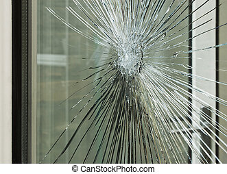 smashed glass window pane - Broken glass window smashed by...