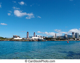 Boat docked in Kewalo Basin Harbor in Honolulu with Condo...