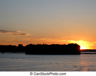 Sunset over the Fort Gorges is on Hog Island Ledge, in Casco...