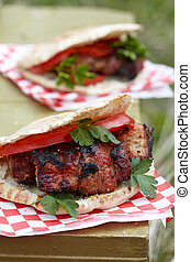 Pita with meat - Pita sandwich with grilled meat, tomato and...