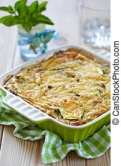 casserole with cabbage and zucchini in baking dish