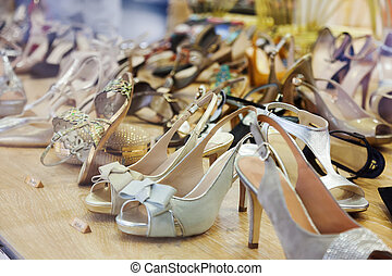 showcase with female shoes at fashionable store