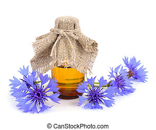 Cornflower with pharmaceutical bottle.