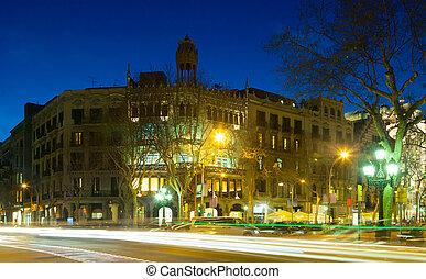 Passeig de Gracia in winter night. Barcelona - Building at...