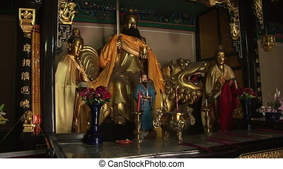 Golden Statues - Painted and golden statues, White Cloud...