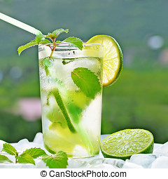 Fresh mojito - Ice cold mojito cocktail and ice cubes,