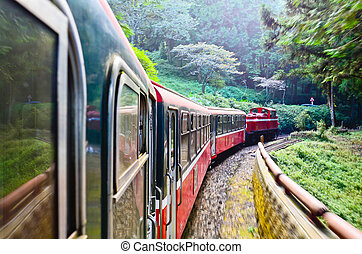Forest railway with train move blurred in Alishan National...