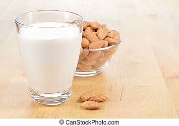 Glass of Almond milk on a table - Almond milk as a...