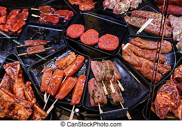 Marinaded meat for grilling in a counter display in a supermarket.  meat at the butcher