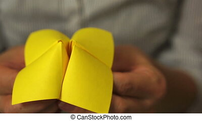 Origami Game Discount 20 Percent - Woman using a folded...