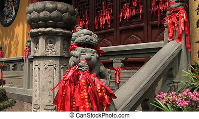 Stone Lion - Stone lion with a mouth full of prayer ribbons...