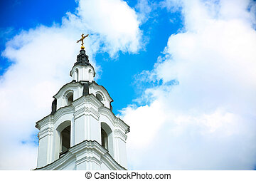 Golden cross in cloudy sky orthodox church