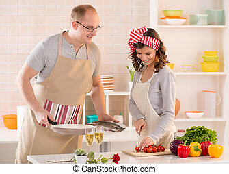 Happy couple in the kitchen - Happy couple preparing food in...