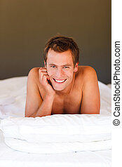 Handsome boy in bed with copyspace - Handsome boy in bed...