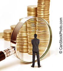 Money and magnifying glass - Businessman checks the money...