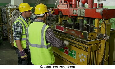 Automation Process - Two men operating industrial station in...