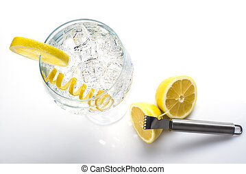 Classic gin and tonic with a lemon twist - Gin and tonic in...