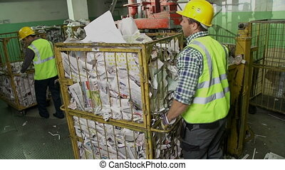 Processing Refinable Materials - Laborers driving trucks up...