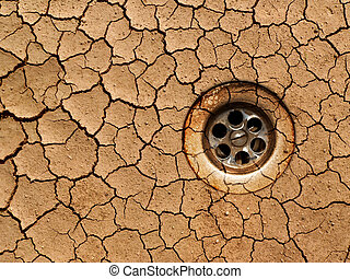 Global warming - Drought - dry crackled ground with water...