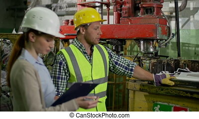Technical Certification - Man demonstrating machine to...