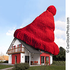 House with red woolen hat - House wearing red woolen hat for...