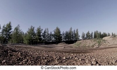 Motocross motorcycle on a dirt road - Driving a motorcycle...