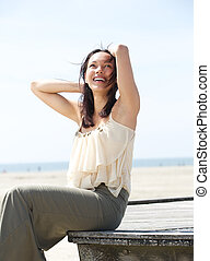 Carefree young woman smiling outdoors - Portrait of a...
