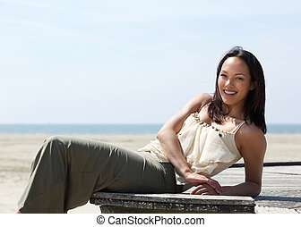 Pretty young woman relaxing outdoors - Portrait of a pretty...