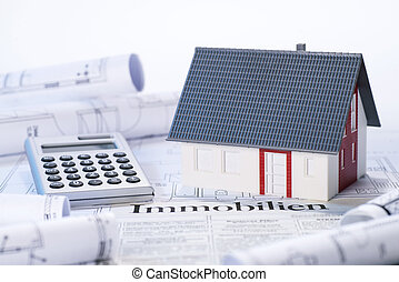 Real estate offer - Model house, blueprints, calculator and...