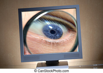 Eye in a monitor - Eye with a magnifier in a monitor
