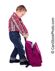 Little boy with heavy schoolbag - Little boy trying to lift...