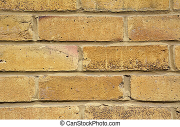 Yellow brick wall - Closeup of yellow brick wall, abstract...
