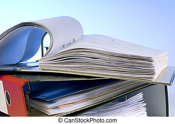 Open file folder on a stack of folders