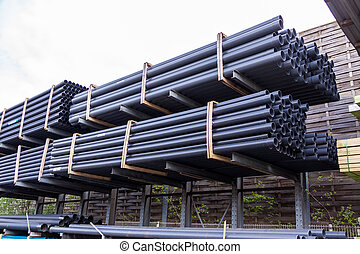 Rolls of plastic pipes in a warehouse yard - Rolls of...