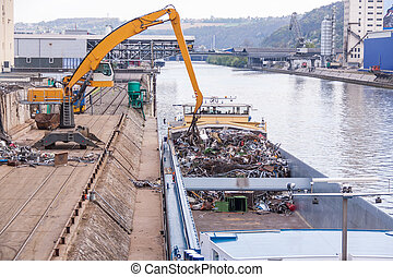 Barge being loaded or offloaded - Open barge being loaded or...