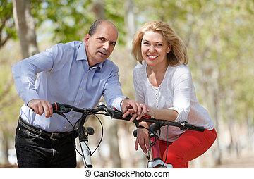 Elderly couple staying in summer park - Loving elderly...