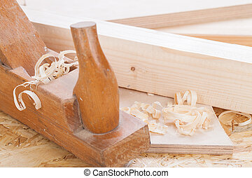 Handheld wood plane with wood shavings - Close up view of a...