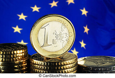 Euro coin and european flag