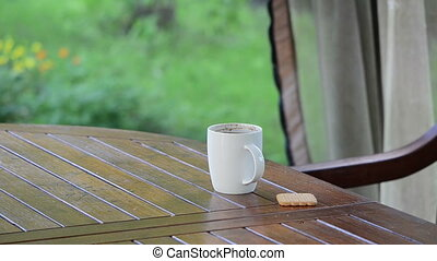 hand coffee cup drink - Hand take cup of steaming hot coffee...