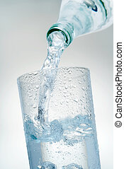 Mineral Water - Mineral water is poured into a glass