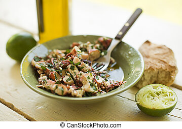 Octopus salad with olive oil, lime and parsley