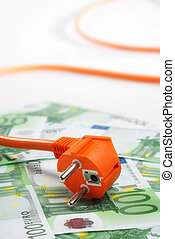Plug and euro bills - Plug is located on a lot of 100 euros...