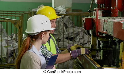 Technical Audit - Close up of male worker and female...