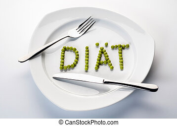 Peas forming the word diet on a plate. - Peas forming the...
